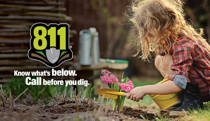 Little girl digging in garden. Call 811 before you dig.