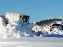 BHP crews work to clear the snow around the Lange Substation